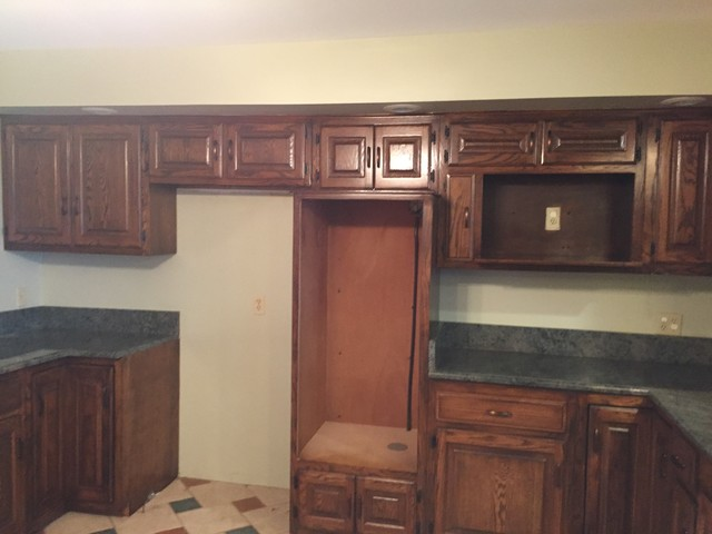 Honey oak kitchen that we refinished in a nice medium brown ...