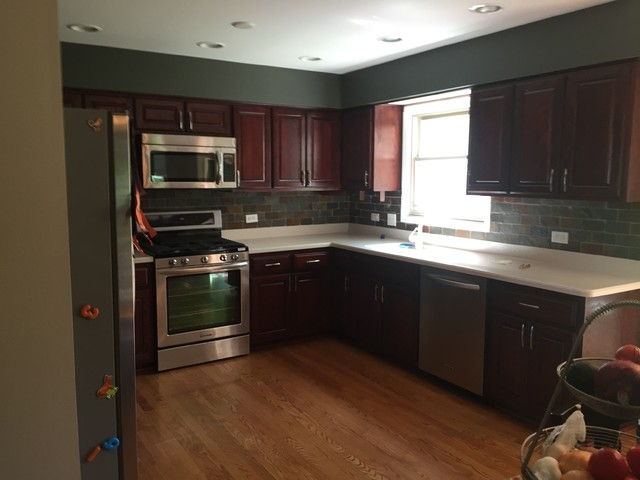 Before Kitchen Was Light Oak, After Refinishing It Is A